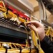 Technician attaching fiber optic - Stock Photo