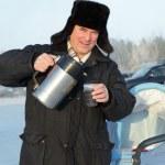 Man pouring tea outdoor — Stock Photo #8639419
