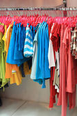Hanging colourful clothes — Stock Photo