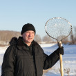Fisherman with ice fishing skimmer — Stockfoto