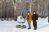 Family with baby carriage — Stockfoto
