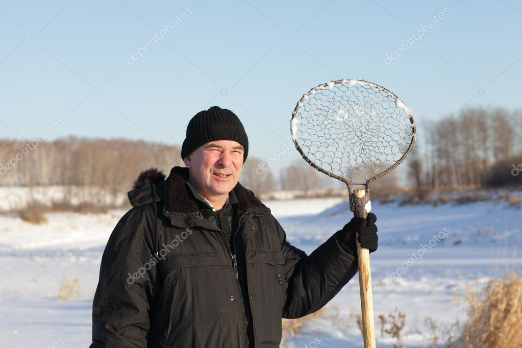 The fisherman posing with hand made ice fishing skimmer, Siberia — Stock Photo #8747204
