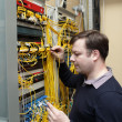 Network engineer jumpering fibre optic — Stock Photo
