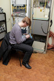 Network engineer measuring fibre optic — Stock Photo