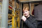 Technician showing fibre optic patch cord — Stock Photo