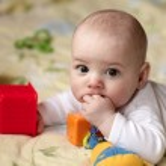 Baby sucking his finger — Stock Photo