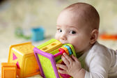 Boy biting toy — Stock Photo