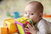 Boy biting toy — Stock Photo