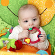 Royalty-Free Stock Photo: Baby biting rattle