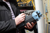 Adjustment of fibre optic reflectometer — Stock Photo