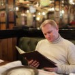 Man reading menu — Stock Photo