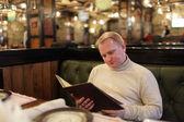 Man reading menu — Stock Photo