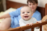 Happy baby in cot — Stock Photo