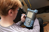 Engineer setting reflectometer — Stock Photo