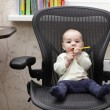 Baby on office chair — Stock Photo