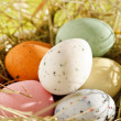 Stock Photo: Easter chocolate eggs in the nest