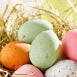Easter chocolate eggs in the nest — Stok fotoğraf