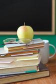 School chalkboard and books — Stock Photo