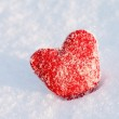 Red heart on the snow — Stock Photo