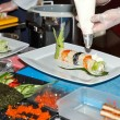 Chef preparing sushi in kitchen — Stock Photo #8695327