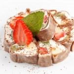 Tiramisu Sushi Roll garnished with Strawberry and Mint — Stock Photo #8696830