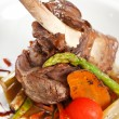 Lamb chops on a bed of vegetables — Stock Photo #8698344