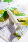 Airliner with a maps — Stock Photo
