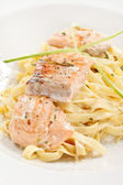 Tasty pasta with cream, salmon and cheese — Stock Photo