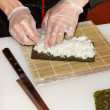 Stock Photo: Chef preparing sushi in the kitchen