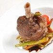 Lamb chops on a bed of vegetables — Stock Photo