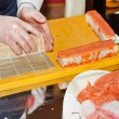 Chef preparing sushi in kitchen — Stock Photo #8726794