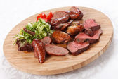 Sausages on a wooden cutting board — Stock Photo