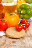 Fresh vegetables and oatmeal cookies — Stock Photo