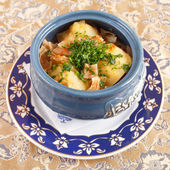 Meat with potatoes in the pot — Stock Photo