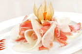 Spanish serrano ham with melon — Stock Photo