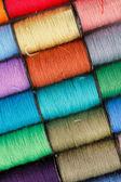 Bobbins of lurex thread — Stock Photo