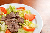 Beef with salad — Stock Photo