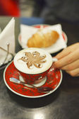 Croissant and a cup of cappucino — Stock Photo