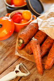 Fresh carrots on the table — Stok fotoğraf