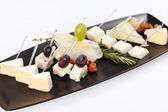 Plate with different types cheese — Stock Photo