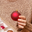 Christmas ball in the hands - Foto Stock