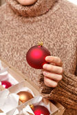 Christmas ball in the hands — Stock Photo