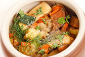 Meat and vegetables in the pot — Stock Photo
