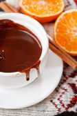 Hot chocolate with mandarin and cinnamon — Stock Photo