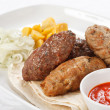 Stock Photo: Tasty cutlets with sauce and tortilla