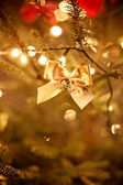Gold bow on the christmas tree — Stock Photo