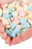 Woman with heart sweets — Stock Photo