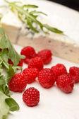 Cheese and raspberry — Stock Photo