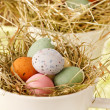 Easter chocolate eggs in the nest — Stock Photo