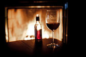Fireplace and wine — Stock Photo